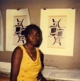 Artist: BUTLER, Roger | Title: Banduk Marika, with her linocut, Djanda and the sacred waterhole, Canberra, 1984 | Date: 1984